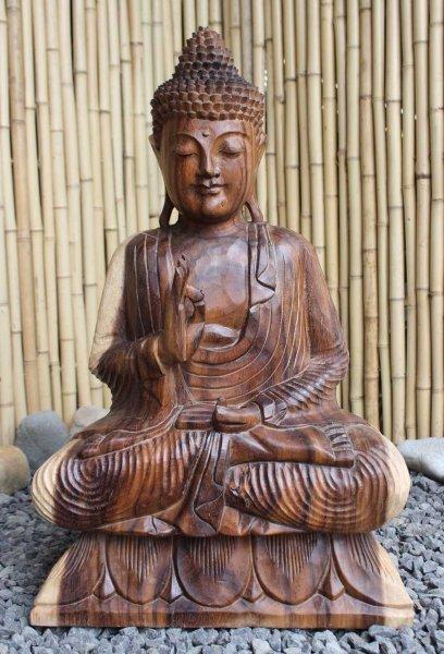 Buddha Figur aus Holz mit lehrender Geste