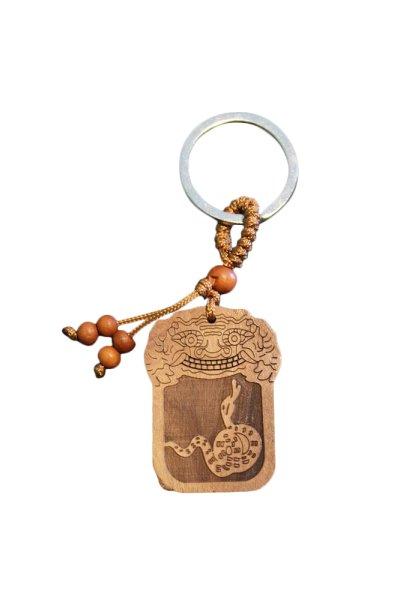 Schlüsselanhänger mit Schlange aus Rosenholz